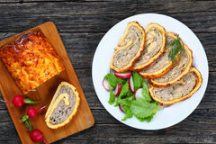 Chicken mushrooms Meatloaf with fresh salad. Delicious ground chicken mushrooms spicy Meatloaf roll-up in golden cheesy crust cut in slices and lettuce radish Royalty Free Stock Images