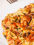 Chicken and mushrooms in tomato sauce with spaghetti Royalty Free Stock Image