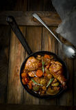 Chicken with mushrooms and vegetables, stewed in wine. Stock Image
