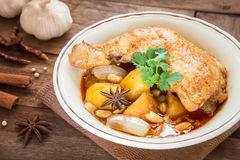 Chicken mussaman curry in bowl and herb Royalty Free Stock Images