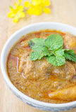 Chicken Mussaman Curry. On wood background Stock Photo