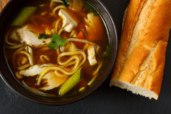 Chicken noodle soup. The popular comfort food of chicken noodle soup a favorite variety with crusty bread Royalty Free Stock Photo