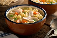 Chicken Noodle Soup. A bowl of delicious homemade chunky chicken noodle soup Stock Photo
