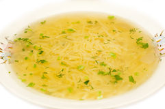 Chicken noodle soup - broth closeup. Traditional chicken noodle soup - broth Stock Photography