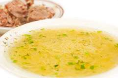 Chicken noodle soup - broth closeup. Traditional chicken noodle soup - broth Stock Image