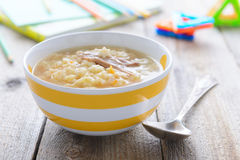 Chicken noodle soup for children nutrition on wooden table Royalty Free Stock Image