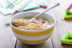 Chicken noodle soup for children nutrition on wooden table Stock Photography