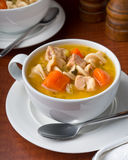 Chicken Noodle Soup. A cup of delicious hearty chicken noodle soup Royalty Free Stock Images