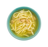 Chicken noodle soup in a green bowl Stock Images