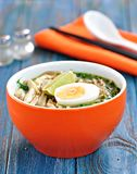 Chicken noodle soup with green onion, ginger, coriander and chili pepper. Asian cuisine. Stock Image