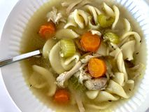 Chicken noodle soup. Homemade chicken noodle soup in a white bowl stock image