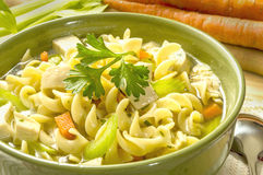 Chicken noodle soup. Hot bowl of chicken noodle soup ready to enjoy royalty free stock photo
