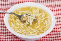 Chicken noodle soup with spoon Royalty Free Stock Photos