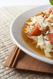 Chicken noodle spicy soup indonesia cuisine. Traditional food from indonesia, called mie jawa or java noodle. some noodle with cabbage, tomato, chicken, with Royalty Free Stock Image