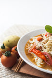 Chicken noodle spicy soup indonesia cuisine. Traditional food from indonesia, called mie jawa or java noodle. some noodle with cabbage, tomato, chicken, with Royalty Free Stock Photos
