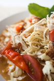 Chicken noodle spicy soup indonesia cuisine. Traditional food from indonesia, called mie jawa or java noodle. some noodle with cabbage, tomato, chicken, with Stock Photo