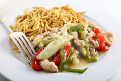 Chicken noodles and fork Stock Photos