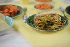 Chicken noodles served on a table with traditional Chinese dishes. A table layout with traditional Chinese food of fresh hot chicken noodles chow mien with Royalty Free Stock Photography