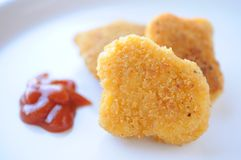 Chicken nugget and ketchup Stock Photos