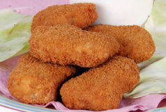 Chicken nuggets. Closeup of battered chicken nuggets on plate Stock Image