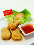 Chicken Nuggets. Image of fried chicken nuggets served on plate isolated with white background stock images