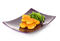 Chicken nuggets and asparagus Royalty Free Stock Images