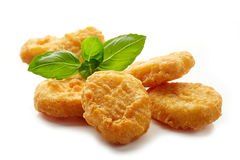 Chicken nuggets and basil leaf Stock Photography