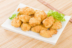 Chicken Nuggets. Battered and deep fried chicken pieces royalty free stock photo
