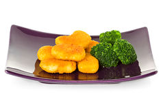 Chicken nuggets and brussels sprouts Stock Photos