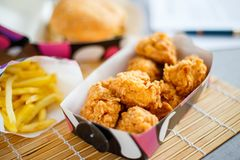 Chicken nuggets with burger and french potato Royalty Free Stock Photography
