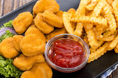 Chicken Nuggets (with Chips) Royalty Free Stock Photography