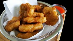 Chicken nuggets with clipping part  on black background stock photo