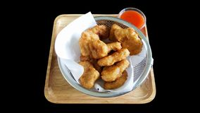 Chicken nuggets with clipping part isolated on black background royalty free stock photo