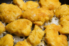 Chicken nuggets cooking Royalty Free Stock Photos