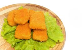 Chicken nuggets. Delicious food , chicken nuggets with cheese on the wooden board Royalty Free Stock Image