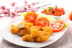 Chicken nuggets on dish. On complex background Stock Photos