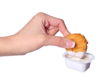 Chicken Nuggets in female hand and mayo Royalty Free Stock Images