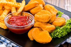 Chicken Nuggets with French Fries Stock Photo