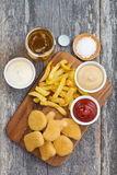 Chicken nuggets with french fries, different sauces Stock Image