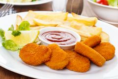 Chicken Nuggets. With french fries and ketchup royalty free stock photo