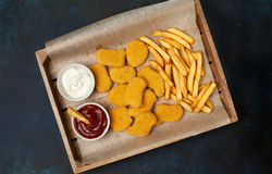 Chicken nuggets and french fries Royalty Free Stock Photo