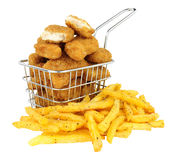 Chicken Nuggets And French Fries In A Small Wire Frying Basket. Breadcrumb covered chicken nuggets and French fries in a small wire frying basket isolated on a stock photography