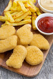 Chicken nuggets with french fries and tomato sauce, closeup Stock Image