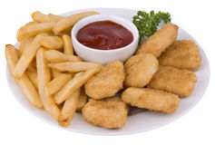 Chicken nuggets. And fried potatoes on a white plate royalty free stock photo