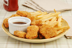 Chicken nuggets and fries Royalty Free Stock Image