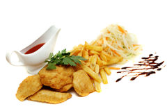 Chicken nuggets and fries Stock Image