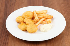 Chicken nuggets frites Stock Images