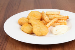 Chicken nuggets frites Stock Photography