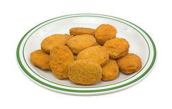Chicken Nuggets On Green Striped Plate Side stock photos