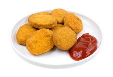 Chicken nuggets with ketchup on small plate Royalty Free Stock Photos